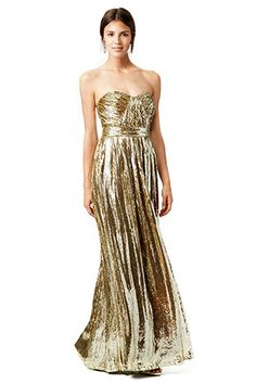 Badgley Mischka Liquid Gold Gown   See More! http://heyweddinglady.com/the-ultimate-guide-to-sparkling-metallic-dresses-for-your-wedding/
