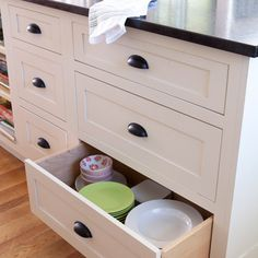 Stow away dishes in deep drawers instead of cabinets.