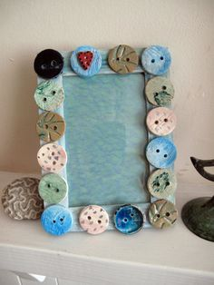 Glue buttons all over a picture frame! Using different sized white buttons would be quite chic.