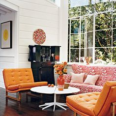 If you use a sofa with a bold pattern, be sure to anchor the space with solid-colored chairs.