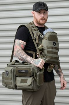 Tactical Baby Gear for Dads Tactical Baby Gear Deuce and Tactical Baby Carrier in Ranger Green. Best baby gear for new Dads. Essential diaper back check list available. Various diaper bags for dads, in Black Camo, Ranger Green, Coyote Brown and Black. Dad Diaper Bag, Diaper Bag Backpack, Diaper Bags For Dads, Camo Diaper Bags, Baby Diper Bags, Best Diaper Bag, Baby Must Haves, Bag Sewing, Baby Shooting