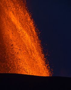 An eruption from Mount Nyamulagira in eastern Congo sends lava high into the air on November 11, 2011.