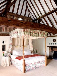 A-frame bedroom + Laura Ashley fabric - Award-winnng country house - via Period Living