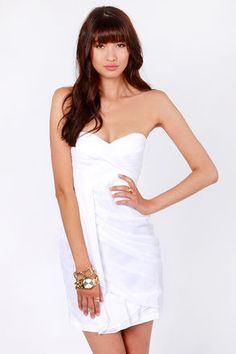 Check it out from Lulus.com! Wait for twilight to bring out your bag of stylish tricks in the Midnight Masquerade Strapless White Dress. Lovely chiffon bodice is beautifully draped to mystify and amaze, with pin tucks of fine fabric defining a strapless sweetheart neckline with a lightly padded bust and elastic across the back. Tulip-layered skirt swishes with each step. Invisible side zipper/hook clasp. Fully lined. Model is wearing a size small. Self: 100��0Polyester. Lining…