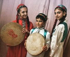 Pamiri children holding a Daf. (Daf is a large Persian frame drum used in popular and classical music.