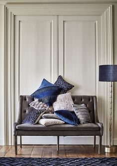 Bring a touch of glamour to your interior with cool shades of blue and grey enhanced with fringing and geometric patterns. Get the Glacial Glamour look.