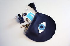 Evil Eye // All Seeing Eye// Navy Blue Leather Clutch Purse // Navy Leather, Iridescent and Blue Accents // Eye of Fatima Design Bleu, Couple Items, Greek Gifts, Evil Eye Jewelry, Unique Purses, Blue Accents, Clutch Purse, Leather Clutch, Purses And Bags