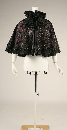 Cape Au Louvre (French)  Date:     ca. 1897 Culture:     French Medium:     silk, cellulous nitrate, gelatin, glass