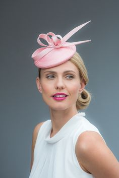 Charlotte: Straw cocktail hat with twist detail. Handcrafted in our London studio.