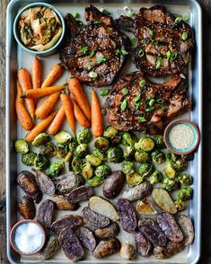 Some of the delicious haul from our road trip yesterday. Local pork rib chops in a Korean BBQ sauce, sesame seeds & green onions, served with kimchi, organic carrots, brussels sprouts, and purple potatoes. Thanks to each the farmers and the butcher for such a delicious meal! Bbq Pork, Pork Ribs, Korean Bbq Sauce, Purple Potatoes, Green Onions, Kimchi, Sprouts, Carrots, Roast
