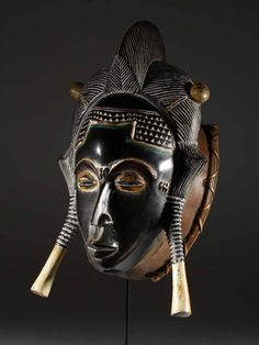 Africa |  Goro Mask.  The Guro people are found in Ivory Coast; their art is closely related to their neighbor's, the Baule's. | Guro masks are usually made of rubber tree wild wood which requires a smoking room so that the wood works thereafter. Guro masks are carved in one piece (horns, tusks and other features are not 'add on' features)