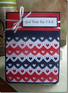 hand crafted patriotic card... edge punched strips of red, white and blue .. luv that she used the MS lacy heart punch ...