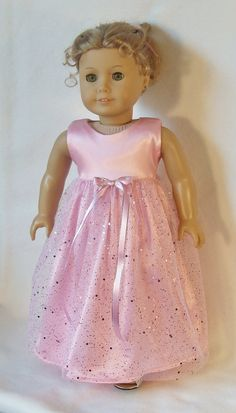 Your doll will look like a Royal Princess in this beautiful pink dress. The top is made & lined with pink bridal satin. The bottom layer of the skirt is