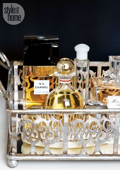 Organize perfumes in a pretty mirrored tray like this one. {Photography by Donna Griffith}
