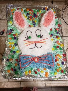 Easter rabbit cake  1 box of classic white cake 1 bag of coconut shavings Food coloring  Jelly beans  Pull and peel twizzlers  2 round cake pans