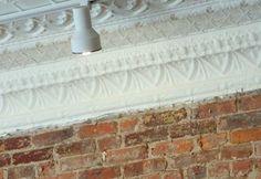 brick walls, tin ceiling