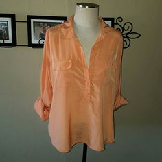 Old Navy Tunic Blouse 3/4 Sleeve Top Old Navy brand. Size XL.  GORGEOUS Tangerine orange. 2nd photo shows truest color. 3/4 Roll tab sleeves. Can be worn down in long sleeve also. Half button up. 2 front chest pockets. Silky like material. 100% Polyester. Excellent condition! Old Navy Tops Tunics