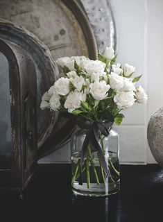 Beautiful, simple, classic - can put an arrangement like this anywhere.     from ZsaZsa Bellagio: shabby chic