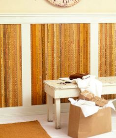 Basement Wall IDEA: Unique Wainscot Measures Up Old yardsticks attached to the wall between 1x4 dividers create a dense and interesting texture on a basement wall. Try this on a focal point wall or a short room divider--the number of yardsticks you can collect will determine how wide each section between the dividers should be.