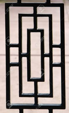 black, near silhouette, of a portion of a deco designed wrought iron gate Stock Photo