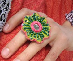 another beautiful crochet ring. Mirror and beads application on felt