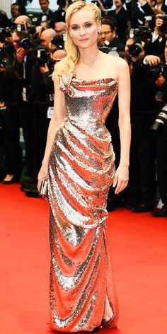This is my most favorite dress...  Kruger walked the red carpet at the Cannes premiere of Amour in a rose gold Vivienne Westwood draped gown, matching clutch and diamond drop earrings.