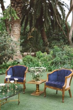 Blue tufted vintage chairs. Jennifer Jeanne Events + Pretty Vintage Rentals.