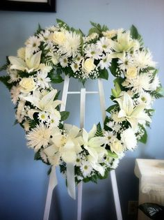 Beautiful all-white, heart-shaped easel spray with Lilies, Roses, Daisies, Fuji/Spider Mums, Gypsophilia