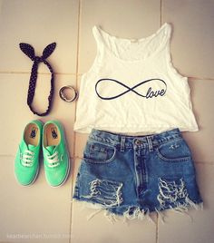 Cropped tank, high waisted shorts, tennis shoes and headband.