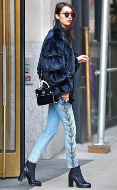 Bella Hadid from The Big Picture: Today's Hot Photos  Flaming hot! The model sports a fur jacket and flame embellished jeans while spotted on the streets of New York City.