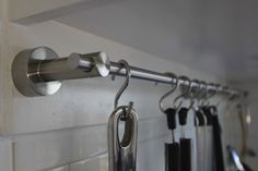 towel rack and for a bag of S hooks make a pretty inexpensive pot and pan storage unit. Why didn't I think of this! I was thinking curtain rod, but hand towel bars are better sized!