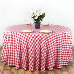 "White/Red 70"" Wholesale Checkered Polyester Picnic Round Tablecloth - Now you can relish that spring picnic feeling any time anywhere with our Perfect Picnic Inspired Checkered Polyester tablecloths. The inspiring and recreational checkered design brings back the memories of happy picnic times in gardens and by the river side. Create a peaceful and serene party ambiance with our luxury Polyester tablecloths fashioned in chic checkered design to exude positive energy and a classy look to your…"