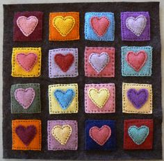 felt Hearts appliqué. Looks like a mini quilt!