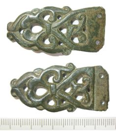DENO-6BEFD3: Early medieval strap end of 'Winchester' type