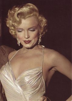 Marilyn Monroe. I LOOOVE HER matching eyeshadow(makeup) w/her dress! Gorgeous!! Perfect!
