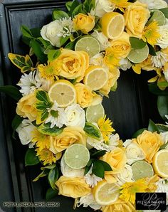 Yellow citrus wreath: absolutely lovely but how do you keep it fresh?  Use it as a candle ring or punch bowl ring at a wedding or a shower.