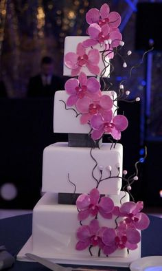 Purple orchids on white squared cake tiers purple