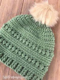 The bead stitch crochet hat is make with alternating rounds of bead stitch and half double crochet. It had a post stitch ribbing around the bottom and a faux fur pom pom on the top.