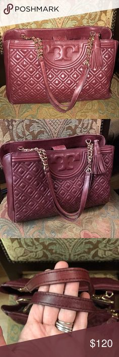 Tory Burch burgundy Quilted bag Authentic Tory Burch bag in preowned condition please see the photos , some color fating on the corners , selling as is Tory Burch Bags