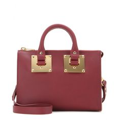 Sophie Hulme - mytheresa.com exclusive Crossbody Holmes leather bag - Mini bags are here to stay and we can't get enough of this 'Crossbody Holmes' model from Sophie Hulme. Wear the downsized maroon style across the body or by the top handles. The ideal size for your key essentials, it'll see you through from day to night with ease. seen @ www.mytheresa.com