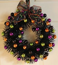 Styrofoam balls, toothpicks, black spray paint, and ornaments all make for a very CUTE Halloween wreath!  :)