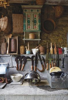 Baciocchi preserved the 16th-century stone walls in the kitchen. He also designed the knives, which are inspired by traditional Tuscan implements.