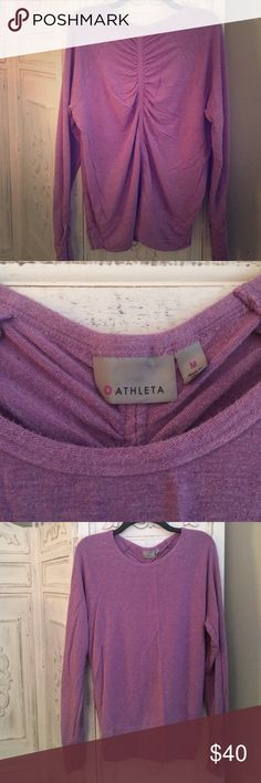 Athleta purple long sleeved pullover Great condition, gently worn and well cared for. Light purple, long sleeved with thumb holes, adorable ruching on the back and the sides of the bottom band. Longer length to cover your assets ☺️👍🏼 Athleta Tops Sweatshirts & Hoodies