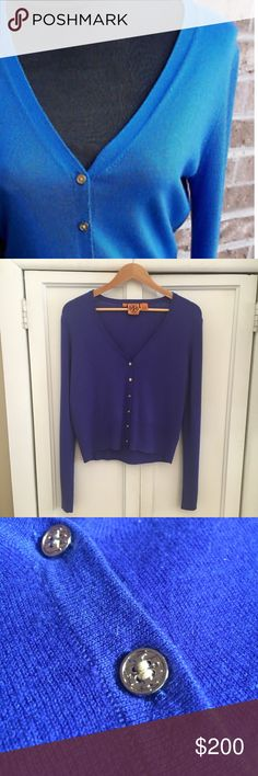 Tory Burch 100% Cashmere Cardigan This little bit of luxury is a little piece of heaven. This 100 percent Cashmere cobalt colored signature Cardigan with delicate gold logo buttons is like wearing a cloud. Ultra soft Cashmere ribbed sleeves and bottom in a beautiful saturated blue color goes with just about everything. Wear it to work, a night out, or anytime you want to feel fabulous! Size XL, NWOT  Tags: designer staples, ribbed, v neck, soft Tory Burch Sweaters Cardigans