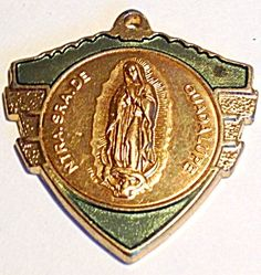 $39 Men's large Our Lady of Guadalupe Virgen Mary Medal (Image1) Large vintage medal, gold tone and green enamel, featuring the Blessed Mother, Virgin Mary, as Our Lady of Guadalupe (Our Lady of Mexico). This is perfect for a man.
