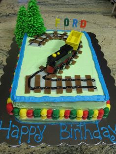 Train cake - great idea for Ian's birthday, but with a 3 instead! :)