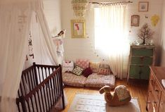 This room would probably not work for my little man (he has a thoroughly un-bohemian accountant dad) but isn't it wonderful? Makes me wish I was a baby once more  @apartmenttherapy.com
