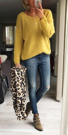 #fall #outfits women's yellow sweater and distressed washed blue jeans