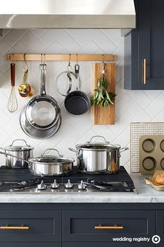 The star of any wedding registry: Shiny new pots and pans. So swap out worn-out, mismatched ones and add this Circulon Genesis set to the list. It's stainless steel on the outside, scratch-resistant nonstick on the inside with raised dots and a Kitchen And Bath, New Kitchen, Kitchen Dining, Kitchen Decor, Hanging Pots Kitchen, Kitchen Paint, Interior Exterior, Home Interior, Interior Design