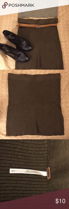Free People body con skirt Cute like new olive green knit skirt. This skirt was a little too big on me and I never wore it. It is a true size large. The skirt is stretchy, doesn't have any zippers or buttons. Feel free to make an offer! Free People Skirts Pencil